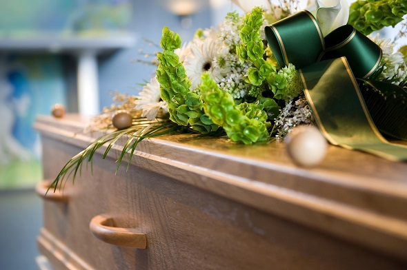 A coffin with a flower arrangement at a mortuary