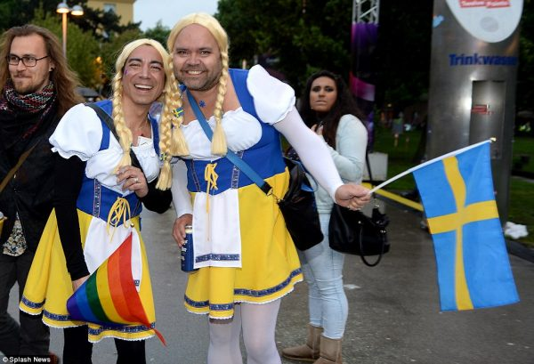 2903e86100000578-3094296-swede_victory_brandishing_a_swedish_and_gay_rights_flag_come_to_-a-31_1432452366366