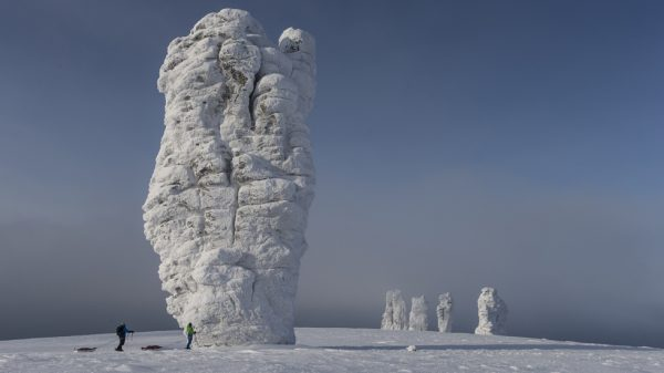 Stefan Glowacz and Uli Theinert on the way to climb a rock formation during the Red Bull 7 Giants project located north of the Ural mountains in the Troitsko-Pechorsky District, Komi Republic, Russia on February 18th 2013 // Klaus Fengler/Red Bull Content Pool // P-20130911-00189 // Usage for editorial use only // Please go to www.redbullcontentpool.com for further information. //